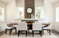 Transitional Dining Room with Oakley Mirror, Hardwood floors, Global Views 7.80188 Lunar Vase, Carpet, Cathedral ceiling