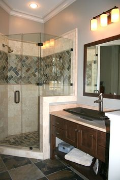 Master bathroom from the Richelieu Plan 1157 http://www.dongardner.com/plan_details.aspx?pid=3257 - With two large walk-in closets, porch-access, a luxurious master bath and a sitting space with shelves and fireplace, the master suite is truly remarkable. #MasterBath #WalkinShower #DreamHome