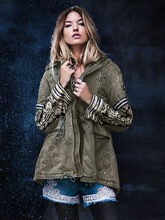 Distressed cargo jacket with beautiful stud and metallic embroidered embellishment on sleeves. Drawstring ties at front of neckline, bottom front, front of waist and at lower back hem. $298