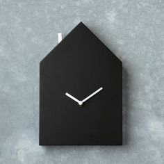 Add some personalization to your time management. Draw numbers, notes or doodles directly on this chalkboard house clock.