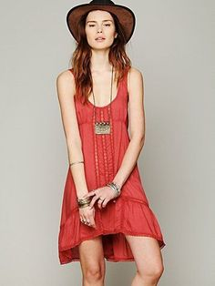 Super soft slip dress with vertical lace trimming down the middle front. Ruffled hi-low hem with lace trimming...