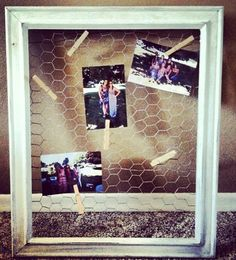Re-painted picture frame with chicken wire and clothes pins.