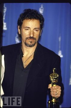 """Bruce Springsteen with his Oscar for Best Song, """"Streets of Philadelphia"""", 1993"""