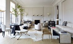 Incredibly chic living room that feels modern & incorporates antiques while sticking to a black & white palette