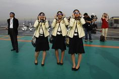 Bus tour guides look at an annular eclipse on a rooftop of the Roppongi Hills complex in Tokyo, May 21, 2012. (Toru Hanai/Reuters)