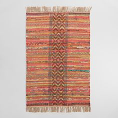 Hand block printed in Jaipur, India, on a handwoven jute and chindi base in a rainbow of bright hues, our exclusive striped rug is a work of art sized to fit any space. Each intricate pattern is stamped by artisans using hand-carved wooden blocks, resulting in subtle color and design variations that make each rug unique.
