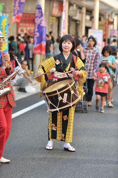 Drummer, from a traditional chindon band, Yoshiwara