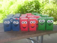 DIY Sesame Street goodie bags    Ideas for favors: crayons, mini coloring/sticker books, rubber duckies, candy, fruit snacks, etc.