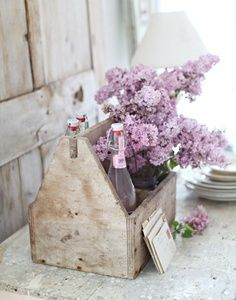 Lilacs in an old tool box.  Love this idea!!