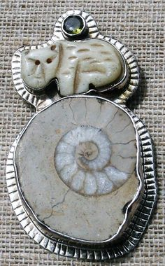 Echo Of The Dreamer cat, peridot & fossil ammonite brooch