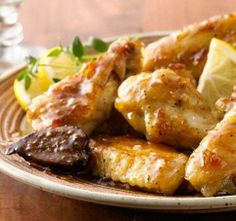 Add a sophisticated touch to your game-day spread and serve these chicken wings, enveloped with a sauce made of fig jam, fresh lemon slices and snappy white-wine vinegar. Perfect for people who don't do spicy, but still want in on the wing party. Fig Appetizer, Cold Appetizers, Appetizer Recipes, Fig Recipes, Lemon Recipes, Pork Recipes, Tomato And Cheese, Dried Figs, Chicken Wing Recipes