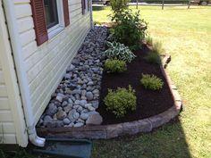 Use rocks or seashells next to foundation to prevent bugs, mud splashes, etc.