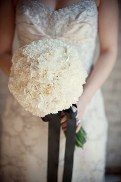 Love this bouquet with the large black ribbon.