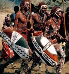 """Africa   Charging Maasai Warriors; during the Eunoto ceremony, warriors charge about the ceremonial circle, or manyatta, blowing long horns and carrying buffalo-hide shields.  Kenya, 1995   ©Carol Beckwith & Angela Fisher. Publication """"African Ceremonies"""""""