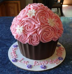 Light pink rose swirl smash cupcake with white fondant daisies.