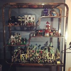 This is how I spent my evening. I took down my crappy Ikea shelves and replaced them with a beautiful Milo Baughman étagère. Now all my Harry Potter Lego can be displayed in all their glory. #Lego #legostagram #afol #harrypotterlego #harrypotter #bricklife #milobaughman #etagere #mcm #midcentury #midcenturymodern #legodisplay #fridaynight by 253bri