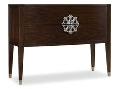 Like a stunning broach on a stylish lapel, the jewelry-like, generously-scaled hardware is striking again the warm walnut veneers of the Medallion Console.