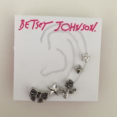 Betsey Johnson earring set (of 5). BRAND NEW. BRAND NEW without tags- never worn. Earrings: bow, star, flower, pyramid, star with gem. Betsey Johnson Jewelry Earrings