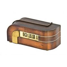 """late 1930's american art deco machine age """"zephyr"""" electric desk clock. the streamlined style body is composed of pressed and folded brass with nicely aged, oxidized copper finish."""