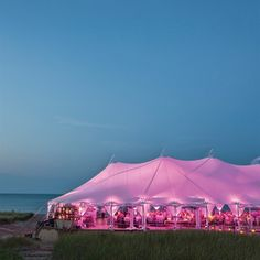 Purple uplighting set a dramatic, romantic vibe in the reception tent.  from the album: A Beachside Wedding in Wilmette, IL