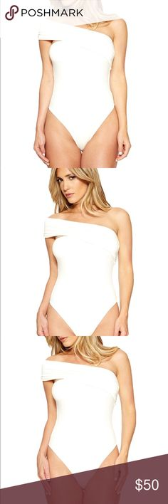 Naked wardrobe white one shoulder strap bodysuit New with tags attached celebrity favorite brand Naked Wardrobe size small bodysuit with on trend asymmetrical design. Made with very soft stretchy comfortable fabric. Available in both black and white. Naked wardrobe developed a cult following due to fashion forward celebrities like the Kardashians, Jennifer Lopez and Kylie Jenner raving about the brands comfort, fit and style. Once you own your first NW piece you will understand why! Sold out…
