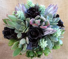Silver, Plum and Blush succulents make a lovely combination. One bouquet and one boutonniere for $220.00  Want these in a different color combination? Let me know and Ill work with you to make your items in the colors and textures you wish.  • Bridal Bouquets measure approximately 6 – 8 inches $185.00 • Bridesmaid Bouquets measure approximately 5 – 6 inches $150.00 • Matching boutonnieres, and/or corsages are $40.00 each.  I use a wired burlap ribbon to wrap the bouquet handles and a simple…