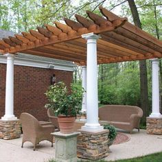 Outdoor Room with Pergola Offers Custom Stone, Columns & Pergola Wood  Thinking a cedar log post, raw wood on stack stone footing