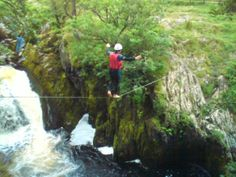 Slack line set up of waterfalls Ingleton
