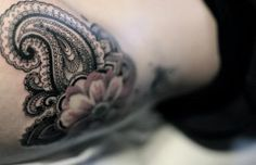 A close up photo of this feminine paisley tattoo by Dodie reveals the depth of detail in the tattoo design