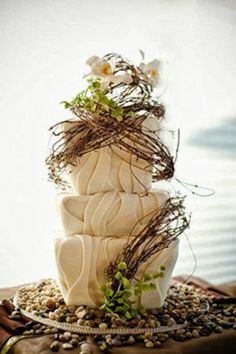 Wow, what a wedding cake. Odd shaped and beautiful - wonder what the price tag on this would be?
