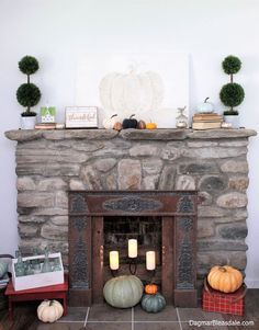 Our mantel in the Blue Cottage all decorated for fall. DIY pumpkin painting made with vintage book page. Fall Home Tour 2017, DagmarBleasdale.com #fall #fireplace #mantel #DIY #pumpkin #vintage #style #bookpages #rustic #stone cottage #farmhouse