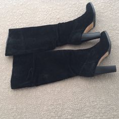 Black suede banana republic knee height boots Slightly loose/slouchy black suede boot with heel.  Barely worn see photos of soles Banana Republic Shoes