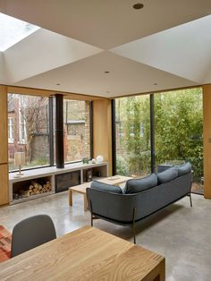 Reclaimed brick walls help this home of modest proportions blend with its historic context in London's Clerkenwell, where it stands on top of a former 19th-century prison.