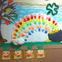 March bulletin board. I like the pot, but not a huge fans of the hands.  Maybe just crinkle paper to make a rainbow.  Twist it, crinkle it, whatever.
