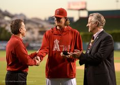 Jered Weaver accepts the nomination for the 2013 Roberto Clemente Award from Owner Arte Moreno