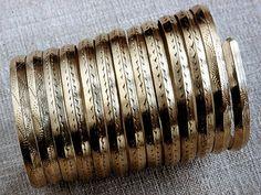 Spiral armband Latgallian Iron Age reproduction, most likely by Daumants Kalniņš