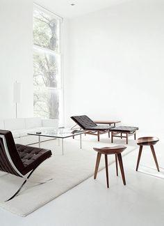 Located near Philip Johnson's famedGlass House reclining seats leather wood stools metal frame windows