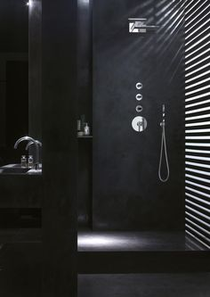 Black bathroom with the Venezia Glass taps by Fantini _