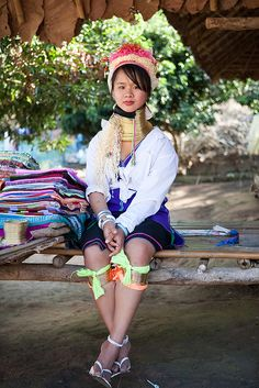 "the giraffe women hill tribe of Thailand:  In the border mountains between Burma (Myanmar) and Thailand live the Kayan, known also as Padaung people. The giraffe women as they are often called, wear heavy copper coils around their necks, which push their faces up and make their necks look long and longneckelegant. The ""secret"" of the ""giraffe"" women is that the clavicle and the ribs descend 45 degrees down from their normal position. The maximum weight of a coil is of 5 kg. This ancient…"