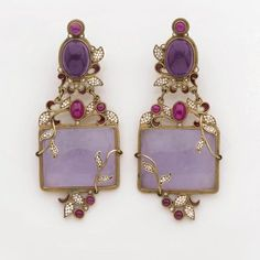 Diego Percossi Papi. Pair of earrings dressed up in floral motifs, set with cabochon amethyst, rubies, beads, jade and purple enamel. Signed.