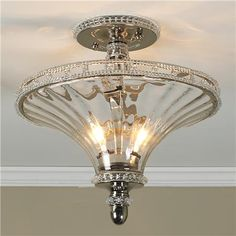 "Jeweled Trumpet Glass Ceiling Light Regally impressive, this luxurious showpiece has elegance withput ostentation. Crystal beads line a double polished nickel rim around fluted handblown glass, bouncing beautiful sparkling light off your ceiling and around your room. 2x60 watts. (candle base socket) (13""Hx13.5""W) 5"" crystal trimmed canopy Product SKU: FM10025 PN Price:  $399.00"