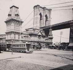 Bob Schwam‎Old Images of New York Group  Brooklyn's Fulton Ferry House and Brooklyn Bridge circa 1885 This view captures the newly built Brooklyn Bridge and Brooklyn's Fulton Ferry House, a beautiful Queen Ann style Victorian building with its ornate mansard roof.  This picturesque scene showing street railways, horse carts, telegraph poles and light fixtures are all vestiges of the 19th century that vanished long ago. The photo was taken around 1885 from the corner of Ever