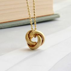 My design inspiration: Tiny Knot Necklace on Fab.