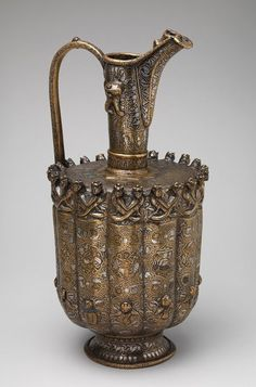 Ewer, Seljuq period (1040–1196), ca. 1180–1210 Iran, Khurasan Brass; raised, repoussé, inlaid with silver and black compound