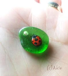 I painted Lady bug on natural shape sea glass. the glass size = 15mm