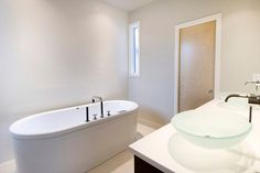 Simple Style Minimalist Bathroom Design Interior With Bowl Sink On The White Vanity Top Beside The White Bath Tub Idea
