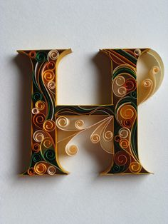 Qulling by paper artist Sabeena Karnik - Of course I love the H but the other letters are equally beautiful