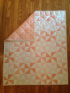 Coral and Gold Metallic Pinwheel Baby Quilt by Nooches on Etsy