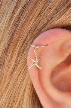 Starfish cartilage earring, gold cartilage hoop, tiny cartilage ring, starfish earring, small cartilage earring, cartilage piercing by Benittamoko on Etsy https://www.etsy.com/listing/470598564/starfish-cartilage-earring-gold