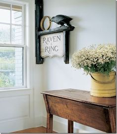 This sign is fabulous! An antique dough table mixes with an early American firkin.